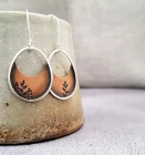 Copper and silver oval earrings with leaf pattern