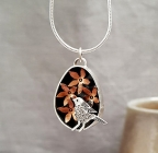 Song bird and copper flowers pendant