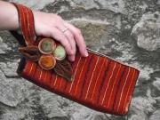 Fantastica Velvet Clutch bag with pompom flower and sparkling bead detail