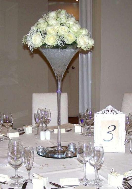 Tall martini glass rose stuffed centre pieces garlands